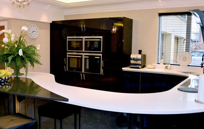 This Wilmslow Kitchen was the first Aster kitchen that Hartwoods designed and installed. Aster Domina is luxury in curves and high gloss lacquer.