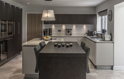 Champagne Matt Lacquer and contrasting Sawcut Tobacco, Nextline Kitchen in Tytherington. Featuring Siemens Appliances and Caesarstone Worktops.