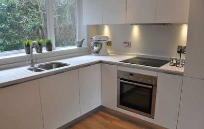 An Italian Bon Tempi Kitchen in a Prestbury Redevelopment. Pure white and simple.